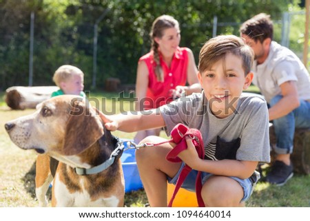 Family taking home a dog from the animal shelter giving new home adopting the pet