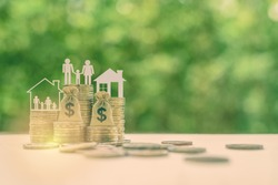 Family tax benefit / residential property or estate tax concept : Family members, house, dollar money bags on rows of rising coins, depicts home equity loan, reverse mortgage, basic needs for living
