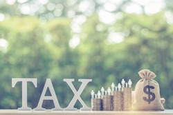 Family tax benefit, residential property or estate tax concept : Word Tax, US dollar bag, family member on four rows of coin, depicts mandatory financial charge, type of levy imposed upon a taxpayer