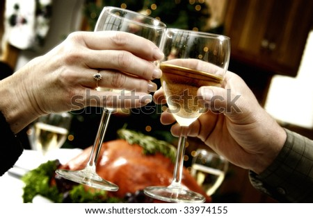 Family toasting at holiday dinner - stock photo