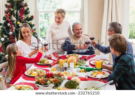 Family Toasting With Red Wine In A Christmas Dinner At ...