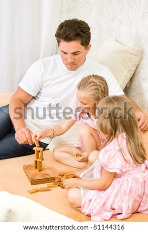 Family together playing dominoes on the couch