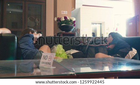 family Tourists, guests arrived at the resort and waiting for the room. the children fell asleep on the sofa in the lobby #1259922445