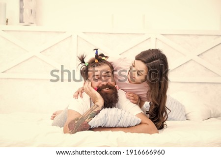 Family traditions. Fathers day with daughter at home. Daughter creating fathers hair. Handsome father with little girl. Happy father and daughter. little girl love her daddy. happy fathers day.