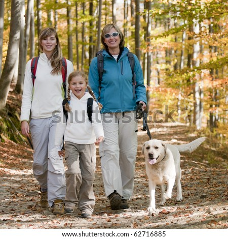 Family trekking with dog