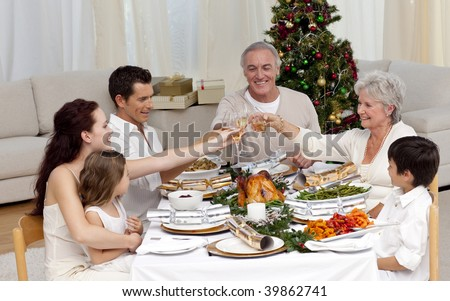 Family tusting in a Christmas dinner at home