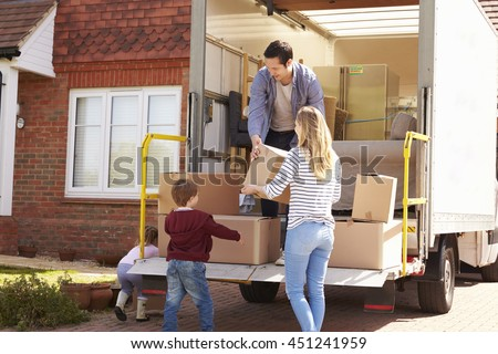Family Unpacking Moving In Boxes From Removal Truck #451241959