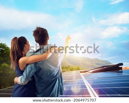 Family uses renewable energy system with solar panel