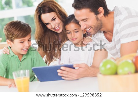 Family using a tablet pc in kitchen