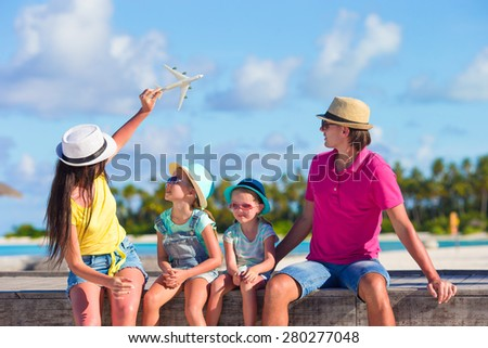 Family vacation. Airplane in woman hand.