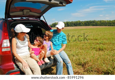 Family vacation. Happy parents with children in car trip