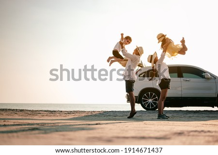 Family vacation holiday,Happy family, parents holding children flying in the sky.Concept family and Holiday and travel.