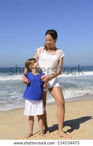 Family vacation: Portrait of mother and daughter on the beach