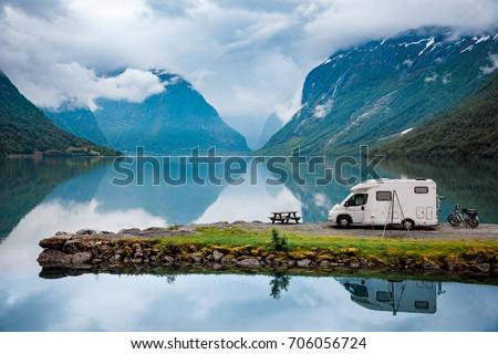 Family vacation travel, holiday trip in motorhome, Caravan car Vacation. Beautiful Nature Italy natural landscape Alps.