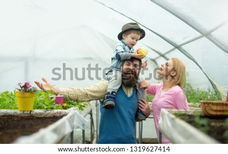 family values. happy family values. family values concept. family values and trust. people in greenhouse
