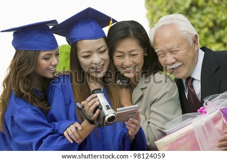 Family Videotaping Graduation - stock photo