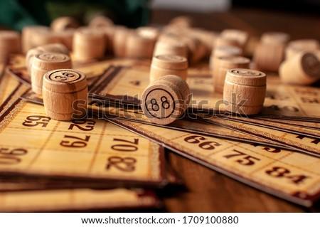 family vintage interesting lotto bingo game, bingo cards and bingo balls lie on a wooden table