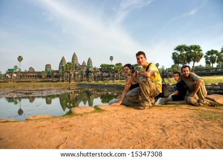 Family visiting  Angkor Wat Temple at sunset, Siem reap, Cambodia.