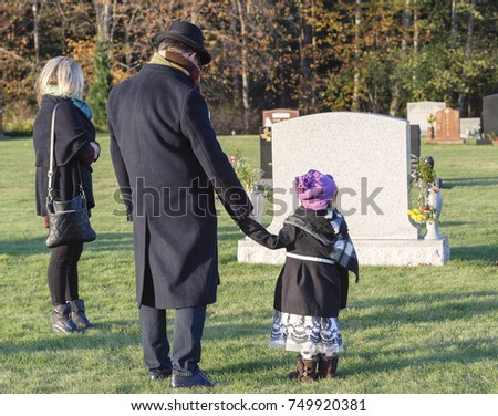 Family visits cemetery  #749920381