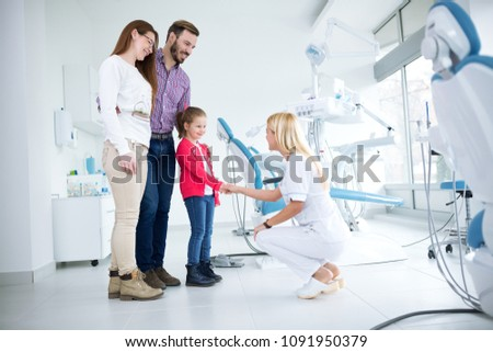 Family visits dentist in dental office for first time together #1091950379