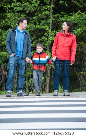 Family waiting to walk safety to the Crosswalk