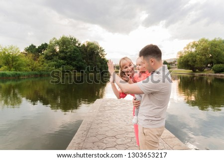 Family walk in the park. Family walks in the park. Man, woman and child in nature. Picture.