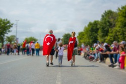 Family walking with Turkish Flags.