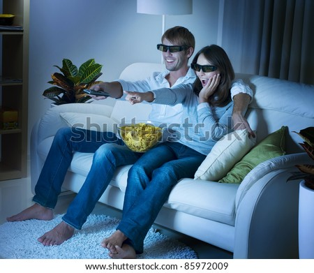 Family watching 3D film on TV