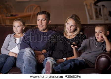 Family watching Television together - stock photo