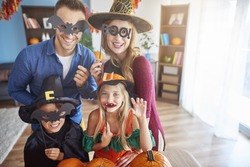 Family wearing funny halloween masks