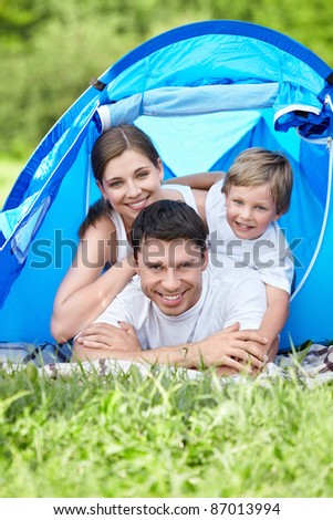 Family with a child in a tent on the nature