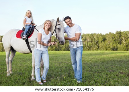 Family with a child on a horse