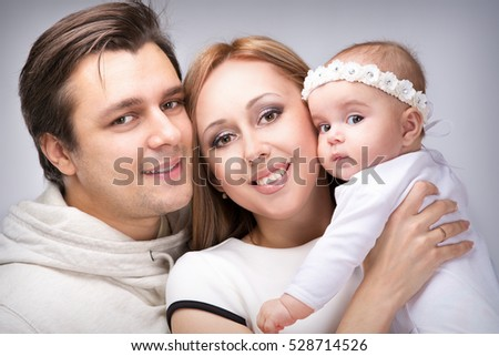 Family with a small child four months