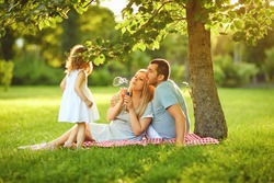 Family with baby on grass in the park