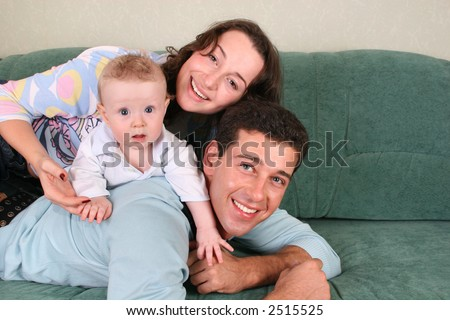 family with baby on sofa 3