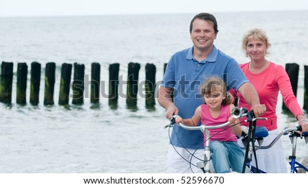 Family with bike at the beach