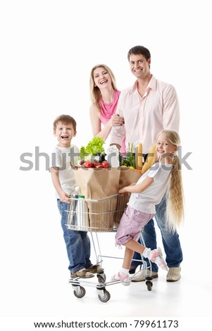 Family with cart with purchases isolated