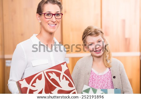 Family with cement floor tiles in home improvement store