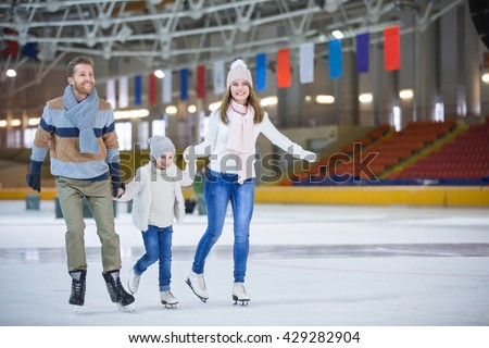 Family with child at ice-skating rink #429282904