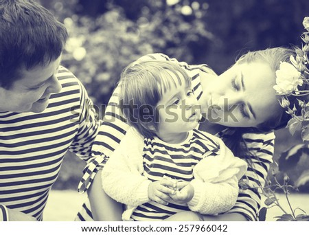 Family with child father and mother in same stripes clothes vintage black and white nature