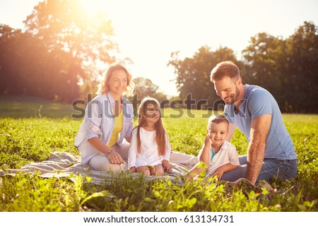 Family with children on picnic in park - Shutterstock ID 613134731