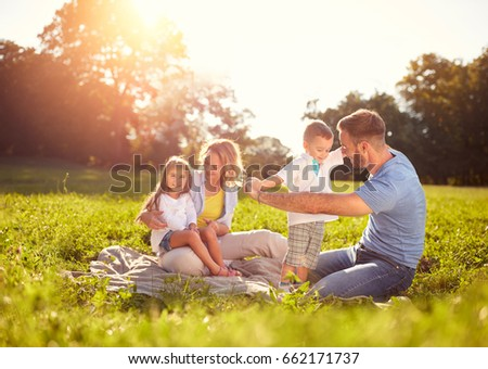 Family with children on picnic in park - Shutterstock ID 662171737