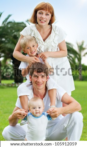 Family with children outdoor in summer park
