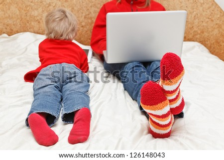 family with computer and touch pad at home
