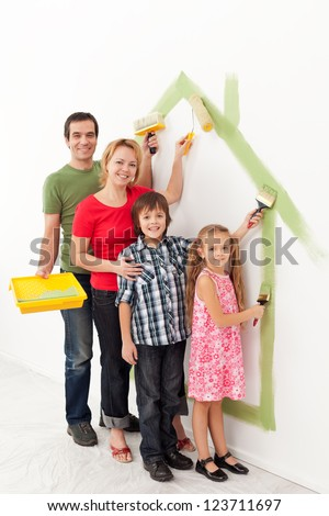 Family with kids painting together in their new home concept - stock photo