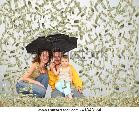 family with little girl with umbrella under dollar rain collage
