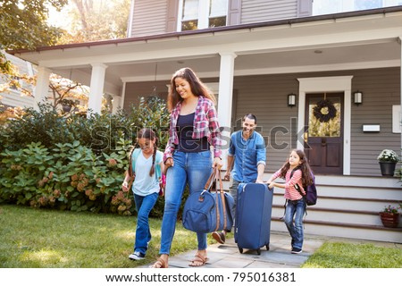 Photo of  Family With Luggage Leaving House For Vacation