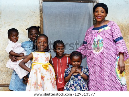 Family with pregnant African woman with five daughters - stock photo