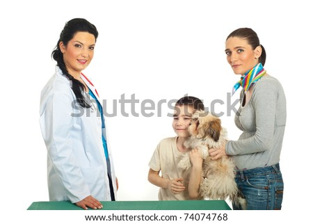 Family with puppy shih tzu visit veterinary doctor woman against white background