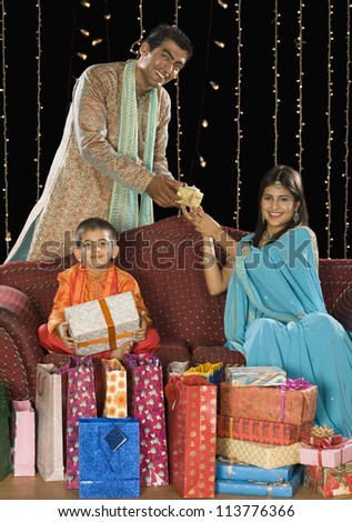 Family with shopping bags and gifts on Diwali festival